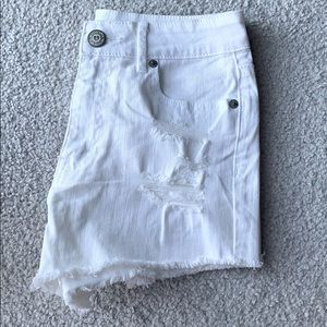 High waisted distressed white jean shorts